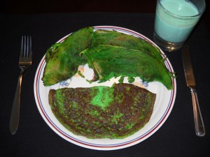 Green Eggs and Ham; I choose to believe that green modifies the whole phrase eggs and ham!
